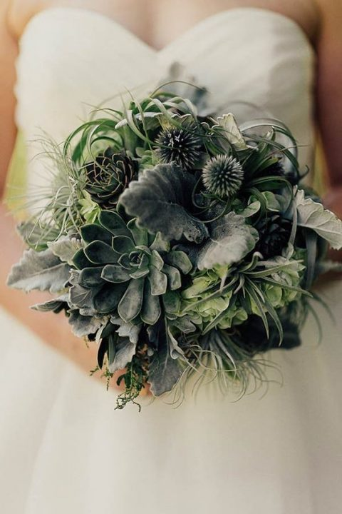 a greenery wedding bouquet with foliage, air plants and succulents