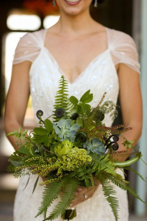 a greenery wedding bouquet with succulents, ferns and foliage