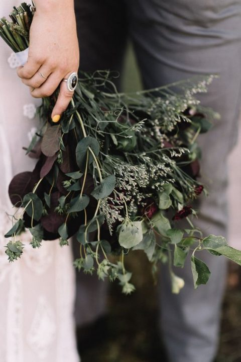 a greenery wedding buquet with dark foliage for a unique look
