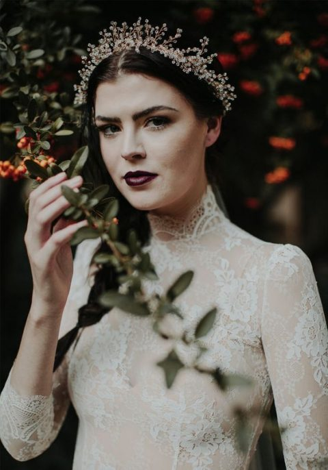 a haunted bridal look with an aubergine lip and no other accents on a pale face