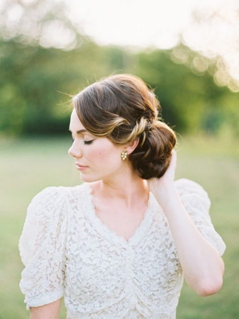 a large side low bun with twists on the front for super elegant vintage-inspired look