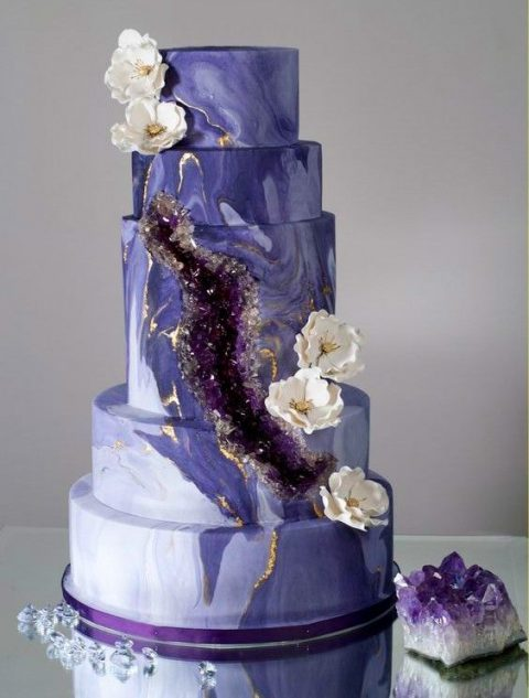 a lavender marble wedding cake with sugar amethyst touches