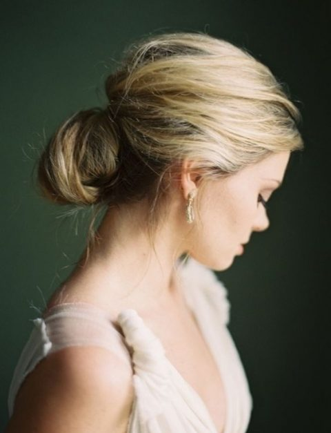 a messy and textural low bun with a bump is a sophisticated idea suitable even for a formal wedding