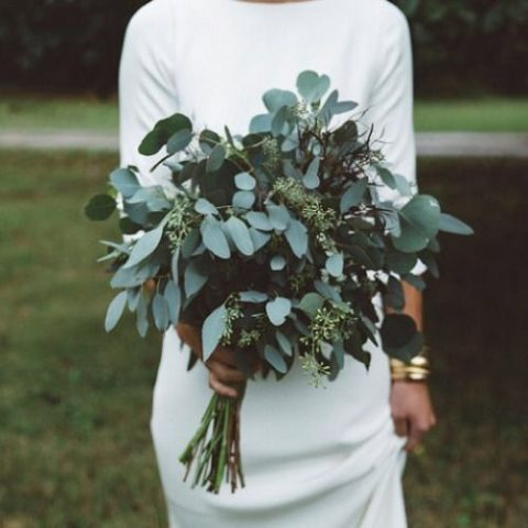 a minimalist bridal bouquet made of different types of eucalyptus