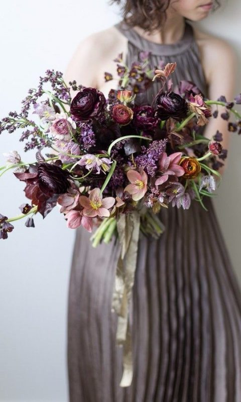 a refined wedding bouquet with deep purple, lavender and dusty pink blooms and much texture