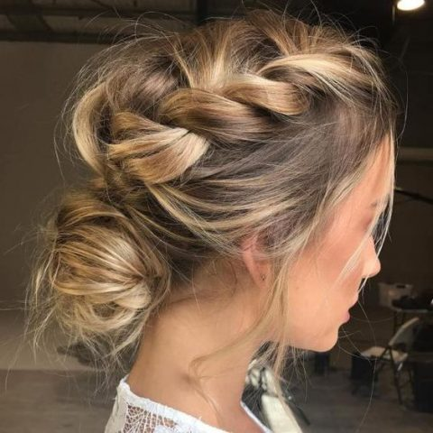 a super messy braid on top plus a messy low bun for an ultimate boho chic bridal look