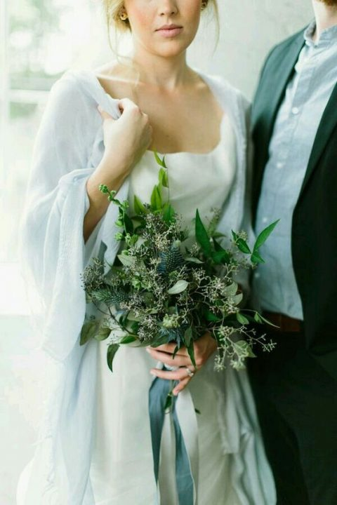 a textural greenery wedding bouquet with foliage, seeded eucalyptus and thistles