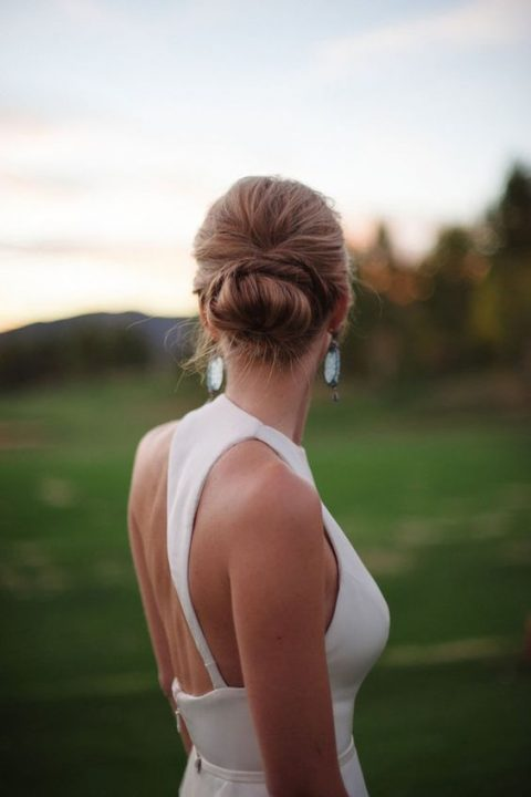 a twisted low bun and a bump on top for a chic modern bridal look