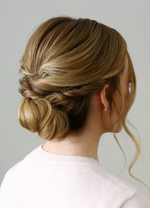 a twisted low bun with some locks down plus a bump is a timelessly elegant idea to rock