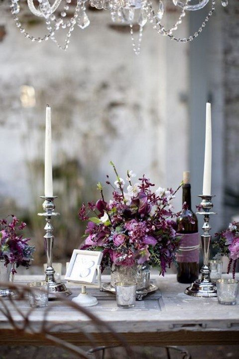 a vintage-inspried silver and purple wedding tablescape with candles