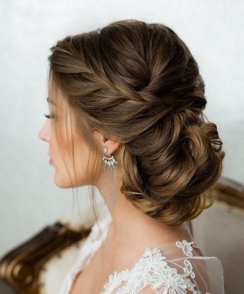 an elegant side braid and a braided and twisted low bun is a very refiend option