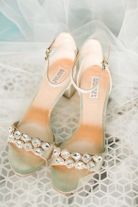 metallic wedding shoes with large embellishments and ankle straps