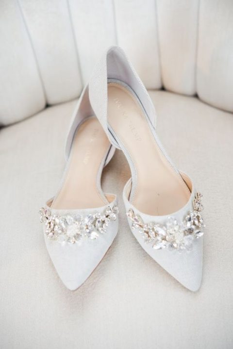 off-white pointed toe flats with large floral embellishments