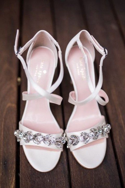 white strappy sandals with floral embellishments