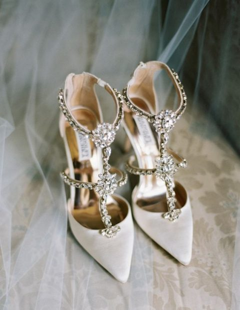 white wedding shoes with heavily embellished straps