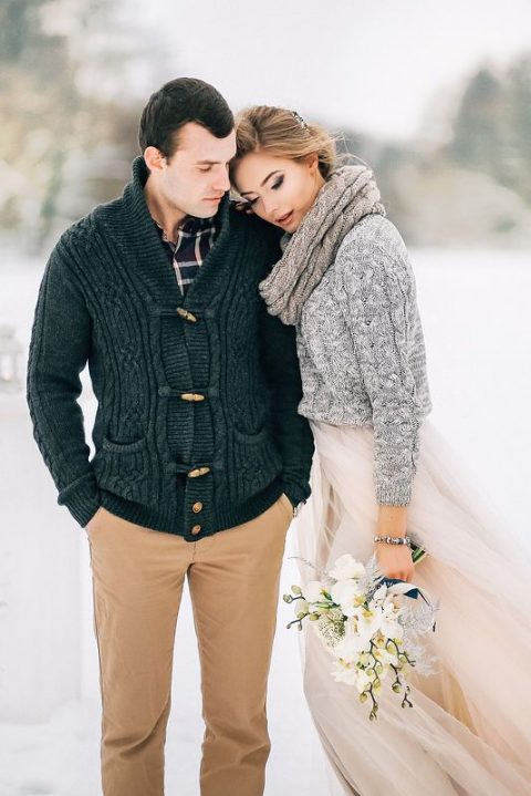 a grey cable knit sweater and a blush tulle skirt, a matching scarf