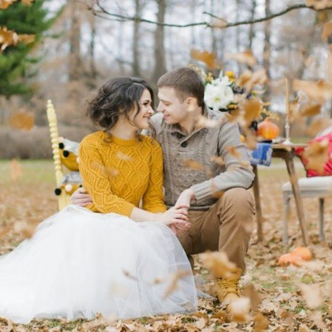 a patterned mustard half sleeve sweater over the wedding dress