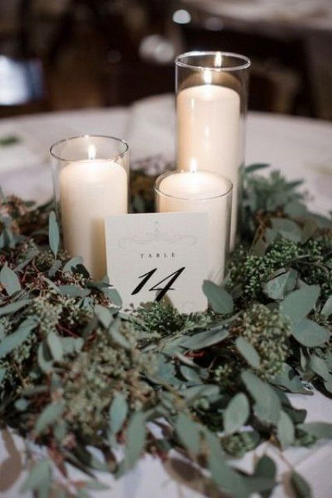 a simple candle trio surrounded with seeded eucalyptus