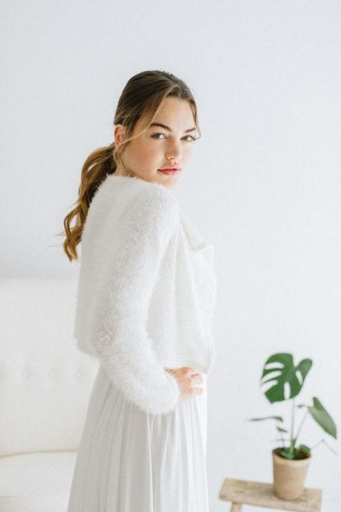 a very cozy white fluffy angora sweater over the wedding dress