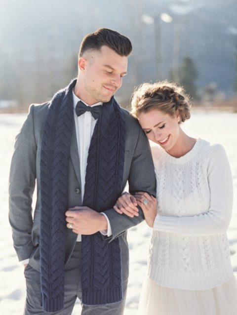 a white cable knit sweater over the neutral wedding dress