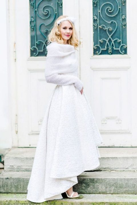 a white high low textural skirt with a train and a chunky off the shoulder sweater with long sleeves