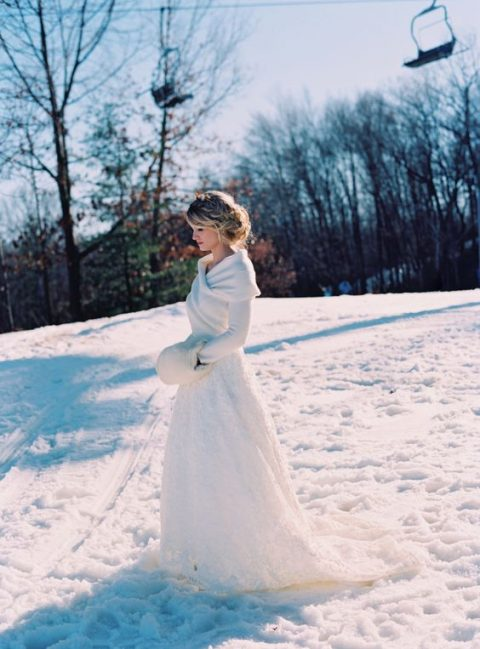 a white wrap sweater over the wedding dress