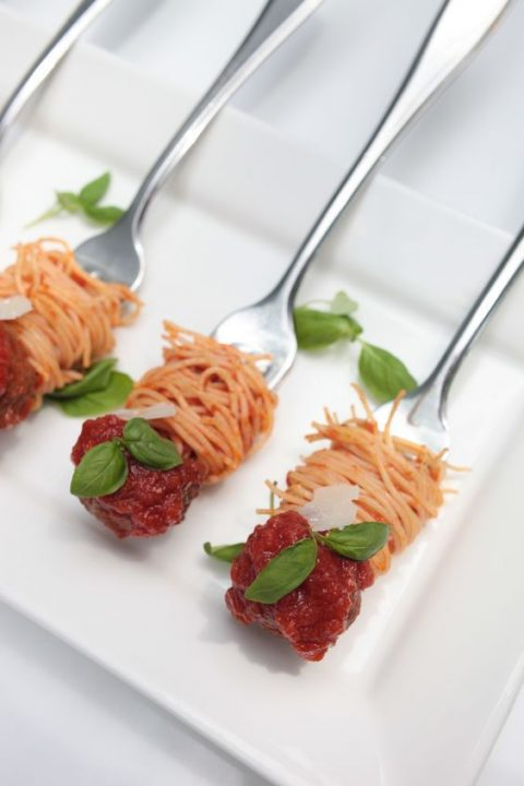 spaghetti and meatball with greenery bite size appetizers