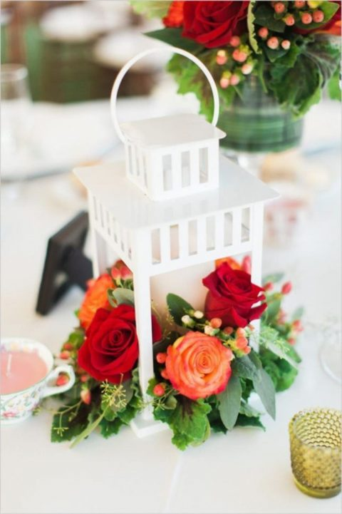 Borrby lantern by IKEA turned into a chic and romantic wedding centerpiece with blooms and berries