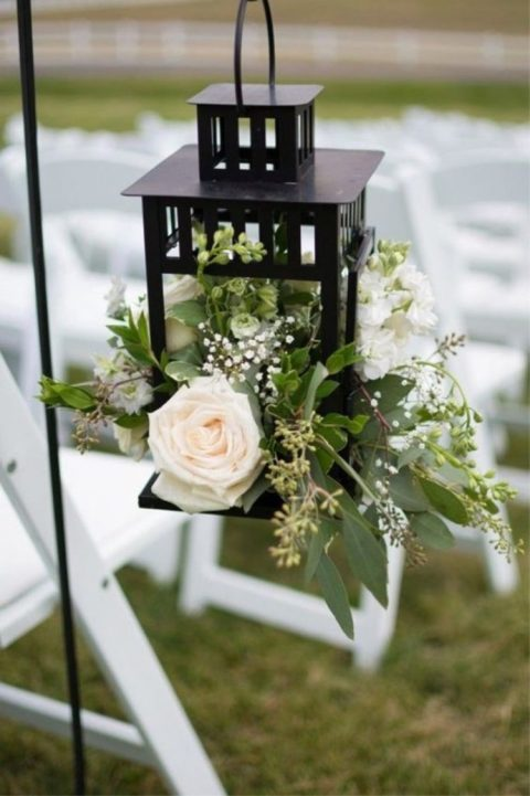Borrby lantern turned into a wedding aisle decoration with lush flowers and greenery