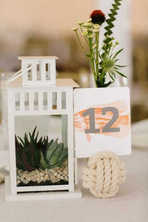 Borrby lantern with succulents planted inside and a rope ball with a table number