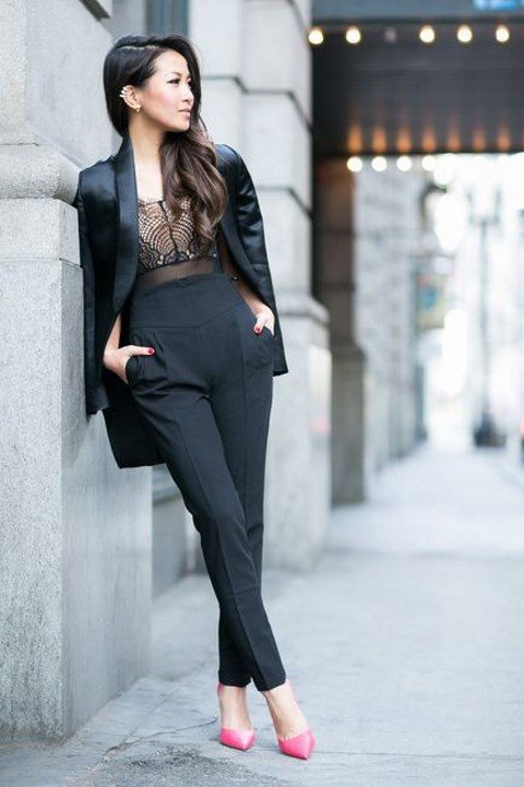 a black jumpsuit with a lace bodice and pockets, a black blazer and pink heels