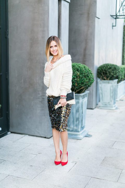 a colorful sequin pencil skirt, a white oversized sweater, red heels and a clutch