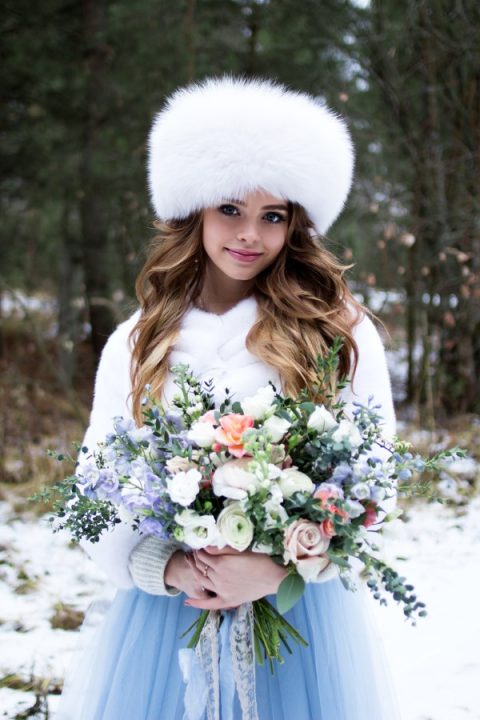 a faux fur hat and a matching coat for a cozy and chic bridal outfit