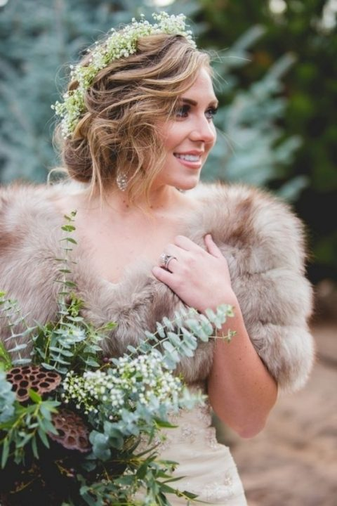 a faux fur wedding coverup makes the look very chic