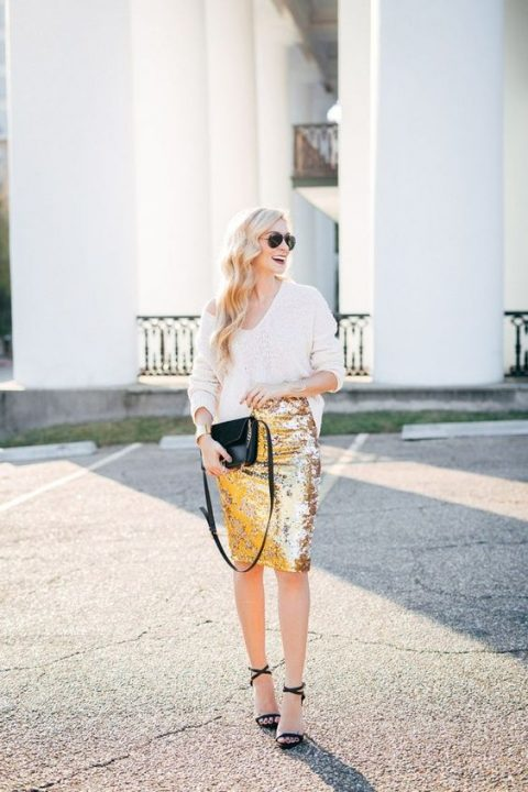 a gold sequin pencil skirt, a white one shoulder sweater, black strappy heels and a black clutch