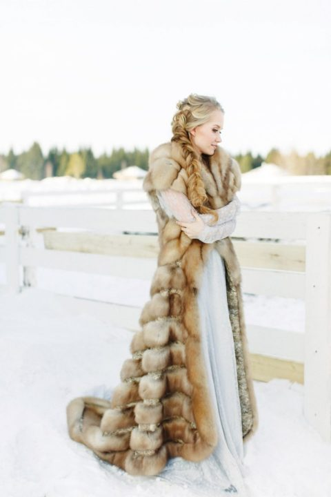 a gorgeous long faux fur sleeveless coat is a stunning accessory for a snowy winter wedding