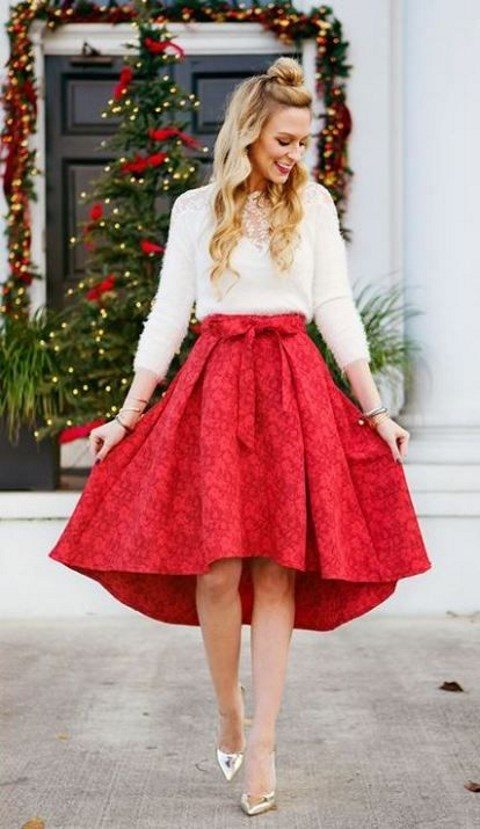 a lffuywhite sweater with a lace insert, a red floral high low skirt, metallic shoes