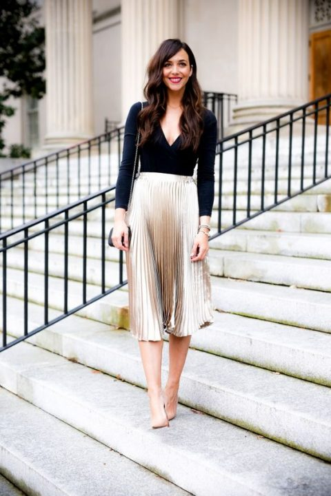a metallic pleated midi, a black bodysuit, nude heels and a black bag