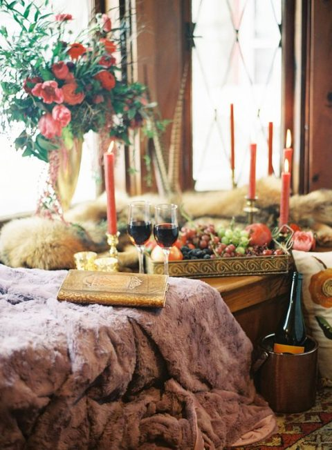 a picnic styled with various faux fur and colorful candles