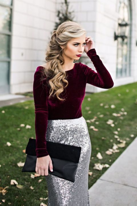 a plum-colored velvet long sleeve shirt, a silver sequin maxi skirt, a black suede and leather clutch