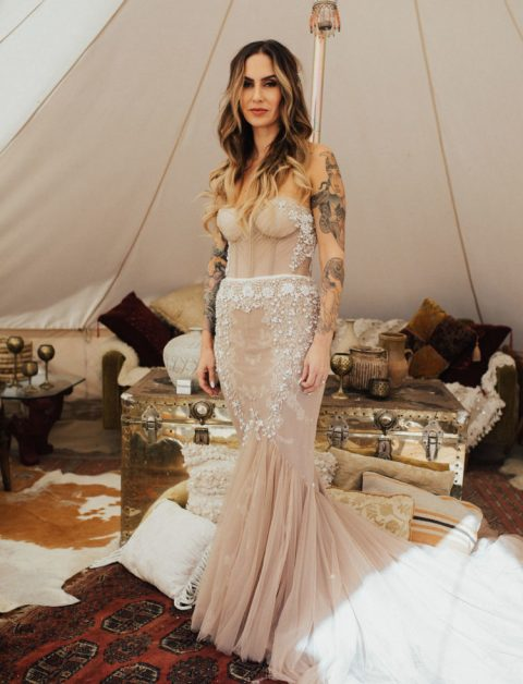 a strapless dusty pink heavily embellished mermaid wedding dress with a train