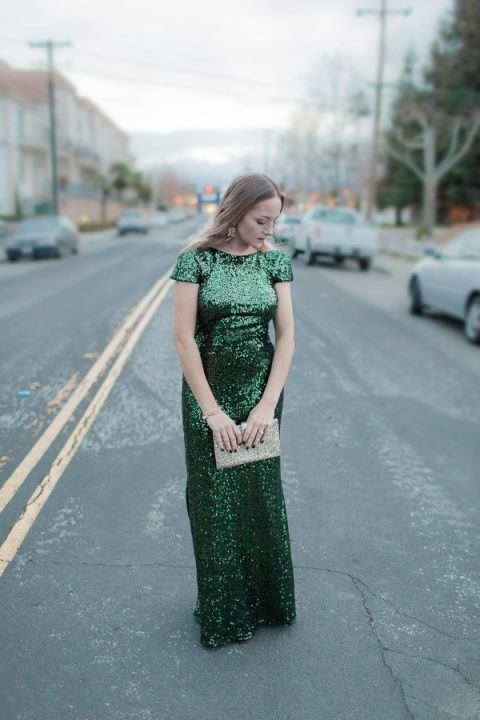 an emerald sequin maxi dress with cap sleeves, a glitter clutch and statement earrings