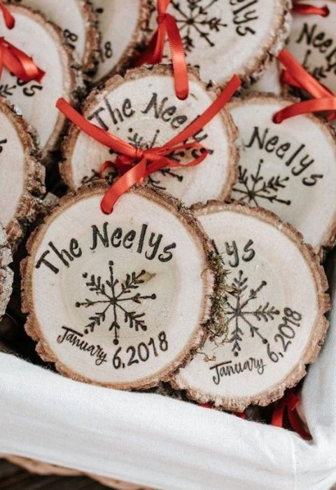 cool wood slice ornaments with the wedding dates and names burnt on them