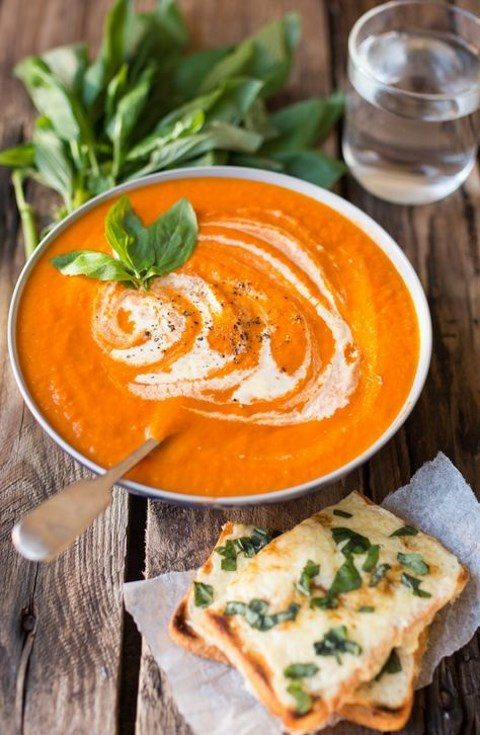 creamy tomato soup with basil cheese on toast is a delicious food idea
