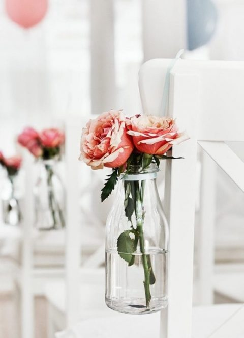 decorate the aisle chairs attaching Ensidig vases with blooms to them