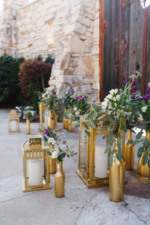 decorate the ceremony space with Borrby lanterns with candles and bottles with blooms