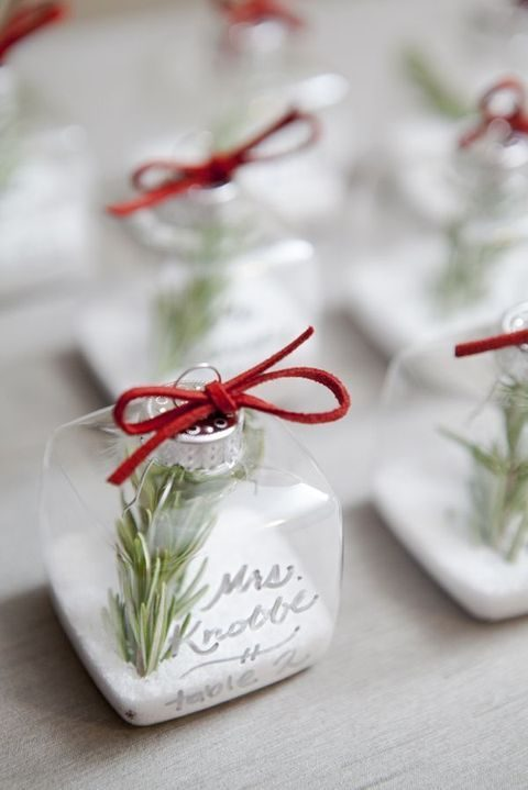 empty square Christmas ornaments filled with fake snow and rosemary