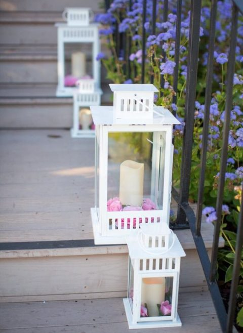 line the staircase with Borrby lanterns with candles and colorful petals