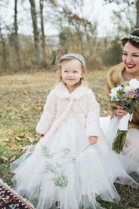 offer your flower girls faux fur coats for an outside ceremony