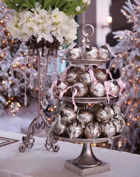 place some cute Christmas ornaments on a cake stand